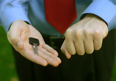 Choose the hand. Business man with hand open with key royalty free stock images