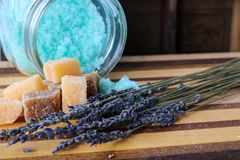 Choose happiness. Blue bath salts with lavender and sugar scrub cubes Royalty Free Stock Image