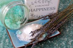 Choose happiness and relax. Choose happiness sign with bath salts and lavender flowers on a soft background Stock Images