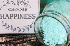 Choose happiness and relax. Choose happiness sign with blue bath salts and lavender flowers Royalty Free Stock Image