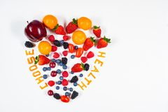 Choose health message in a heart shaped fruit arrangement stock images