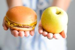 Choose between junk food versus healthy diet royalty free stock images