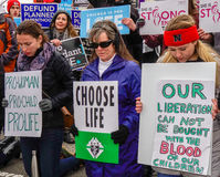 Choose Life. Washington, DC - January 27, 2017: Women kneeling and holding signs advocate against abortion during the annual March for Life royalty free stock photography
