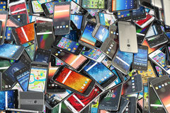 Choose mobile phone. Heap of the different smartphones with diff Royalty Free Stock Image