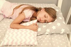 Choose proper pillow to relax well. Healthy sleep tips. Girl sleeps on little pillow bedclothes background. Girl child. Long hair fall asleep pillow close up royalty free stock photos