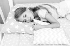 Choose proper pillow to relax well. Healthy sleep tips. Girl sleeps on little pillow bedclothes background. Girl child. Long hair fall asleep pillow close up royalty free stock photography