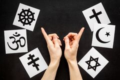 Free Choose Religions Concept. Hands Point On Christianity, Catholicism, Buddhism, Judaism, Islam Symbols On Black Background Royalty Free Stock Photos - 178635438