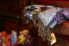 Choose a scarf. Scarves display in shop Royalty Free Stock Photo