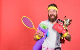 Choose sport you like. Sport lifestyle concept. My goal is health. Sport shop assortment. Man bearded athlete hold sport. Equipment jump rope fitness mat boxing royalty free stock image