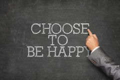 Choose to be happy text on blackboard Stock Images