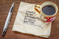 Choose to be optimistic on napkin Royalty Free Stock Image
