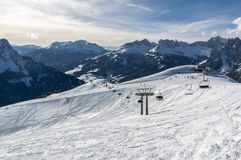 Choose your line. Open field covered with a thick layer of fresh snow, plenty of off piste lines to choose from. Photo taken for the top of the Buffaure skiing Stock Photos