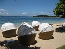 Choose your own cocoon!. Relax in your own beach chair on the beach in Bali with blue skies Royalty Free Stock Images
