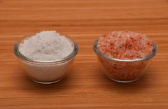 Choose your salt - Himalayan or rock salt (side view) on wood. En bamboo background Royalty Free Stock Photo