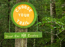 Choose Your Trail sign in Skagway, Alaska at Gold Rush Cemetery Stock Photo