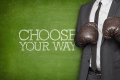 Choose your way on blackboard with businessman Royalty Free Stock Image