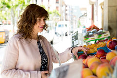 She chooses the best fruit for her family Royalty Free Stock Photography