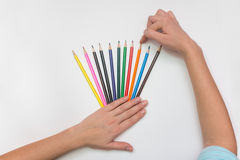 She chooses the correct pencil. Close-up top Royalty Free Stock Photo