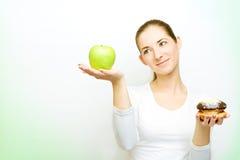 Choosing between apple and cake Royalty Free Stock Image