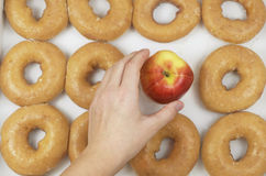 Choosing An Apple Instead Of Donut Stock Images