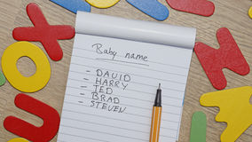 Choosing baby name for a boy Stock Photo