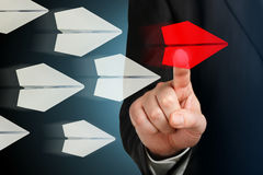 Choosing the best. Hand choosing the red plane on virtual screen Royalty Free Stock Image