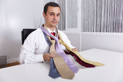 Choosing the best necktie for a working day Royalty Free Stock Photos