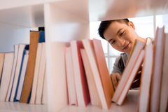 Choosing a book Stock Photos