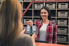 Choosing bowling shoes Royalty Free Stock Images