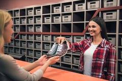 Choosing bowling shoes Royalty Free Stock Photo