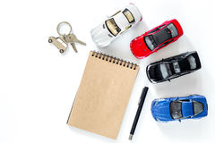 Choosing car concept. Toy car and car keys on white background top view copyspace mockup. Choosing car concept. Toy cars on white background top view Royalty Free Stock Images