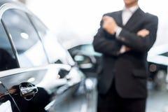 Choosing a car at dealership. Royalty Free Stock Photography