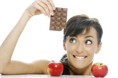 Choosing between chocolate and apple Stock Photo