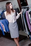 Choosing clothes at the store Stock Image