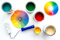 Choosing color for painting. Palette near roller and paints on white background top view royalty free stock images