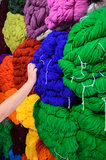 Choosing Colorful Wool Ball. Hand picking a colorful wool ball stock image