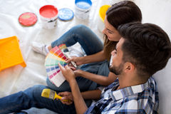 Choosing colors for painting walls at new home. Couple choosing colors for painting walls at new home royalty free stock image