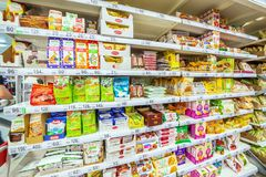 Choosing diabetic products at a mall. Text in Russian: fructose, live sweets, sugar-free, for health, tonic sweets, useful, longev. Russia Samara March 2019 stock image