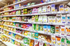 Choosing diabetic products at a mall. Text in Russian: fructose, live sweets, sugar-free, for health, tonic sweets, useful, longev. Russia Samara March 2019 stock photo