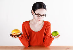 Choosing between doughnut and apple Stock Photography
