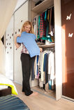 Choosing Dress Near Wardrobe Stock Image