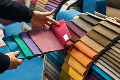 Choosing a fabric color in a store stock photography