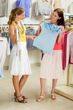 Choosing fashionable clothes Royalty Free Stock Images
