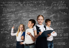 Choosing future profession. Children of school age trying different professions Royalty Free Stock Images