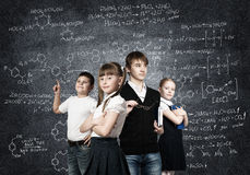 Choosing future profession. Children of school age trying different professions Stock Images