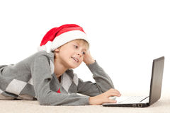 Choosing gifts for Xmas in internet Royalty Free Stock Image