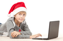 Choosing gifts for Xmas in internet Royalty Free Stock Photo