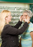 Choosing glasses at the optician Royalty Free Stock Images