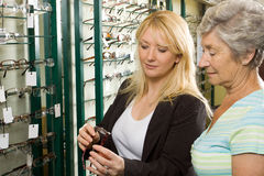 Choosing glasses at the optician Stock Photo