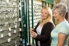 Choosing glasses at the optician Stock Image